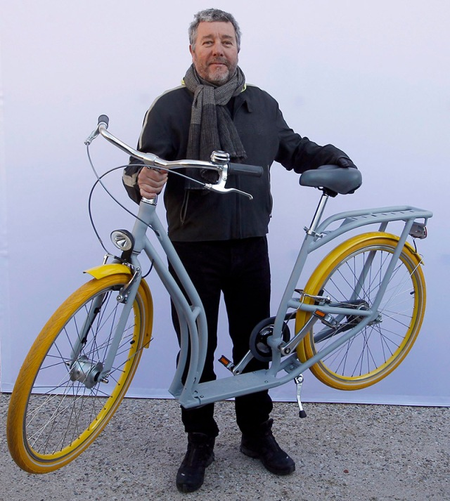 "French designer Philippe Starck presents his ""Pibal"" public bicycle during a photocall at the Bordeaux city hall"